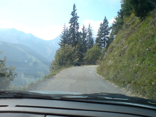 Narrow mountain road through windshield